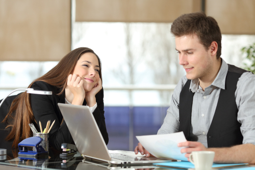 signs someone has a crush on you at work
